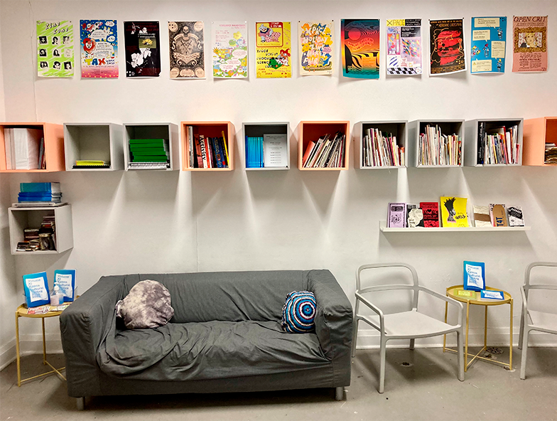 XPace Zine Library - showing art, bookshelves, couch